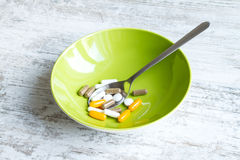 Food supplements. Vitamins and dietary food supplements Royalty Free Stock Photos