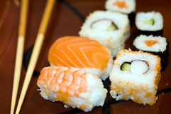 Food: sushi maki chopsticks macro. Prepared, delicious sushi and chopstics macro Stock Photos