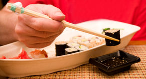 Food Sushi and man's hand Royalty Free Stock Photography