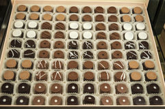 Food and sweets: a box of different tastes of chocolates: milk chocolate, dark chocolate and white chocolate Royalty Free Stock Image