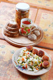 Food on the table. Lunch on a plate with bread, meat balls and tea royalty free stock images