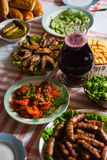 Food on the table. Grilled food on the table with salads Royalty Free Stock Images
