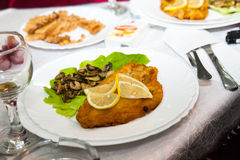 Food and table arrangement with fish and vegetables Stock Photo