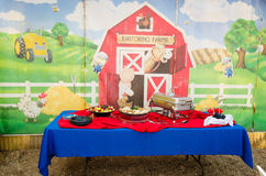 Food table at Barn theme 2nd birthday Royalty Free Stock Photography