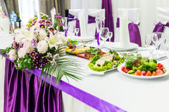 Food table decorated with flowers. Food table decorated with purple and white beautifu flowers for wedding royalty free stock photos