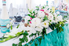 Food table decorated with flowers. Food table decorated with white beautiful flowers for wedding Royalty Free Stock Photos