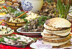 Food on the table. Festive abundance of food on the table Royalty Free Stock Photo