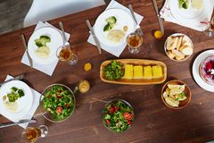 Food on table. Overview of homemade meals and drinks sesrved on wooden table Royalty Free Stock Photo