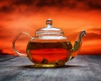 Teapot of fresh tea on sky background Stock Photo