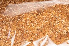 Sprouted Grains Bread Texture in Plastic Wrap. Food texture background of bread made with freshly sprouted organic grains , top view in plastic wrap stock photography