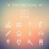 Food thin line icon set. Food and drink thin line icon set for web and mobile. Set includes- cake, candy, lollipop, cupcake, ice cream, honey dipper, popsicle Stock Photography