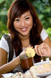 Food time!. Young attractive asian women at a picnic Stock Image