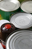 Food tins cans. Close up of tops of tinned cans containing food Stock Photos