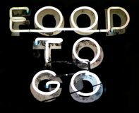 Food To Go. Vintage Food To Go neon sign Stock Photos