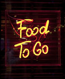 Food To Go sign. Food To Go neon sign stock photography
