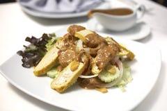 Food from tofu. Yellow tofu and peanut sauce Royalty Free Stock Image