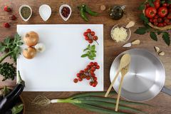 Food top view, kitchen wooden top work with white cutting board. Tomatoes, vegetables and saucepan, copy space template stock photography