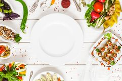 Food top view white plate buffet cater restaurant. Food assortment top view. Empty white plate flat lay surrounded by dishes on the table. Buffet catering and royalty free stock image