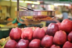 Food topic: Balance and red apples Royalty Free Stock Images