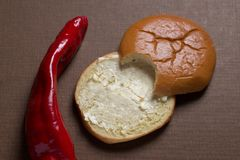 Red Pepper and Bun Food in two half Pieces Royalty Free Stock Images