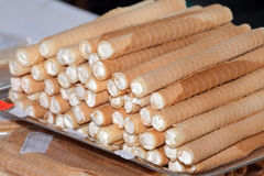 Food at the traditional street market. Traditional crackers filled with whipped cream at the street market Royalty Free Stock Photography