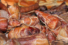 Food at the traditional street market. Smoked meat at the street market Royalty Free Stock Photo
