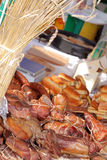 Food at the traditional street market. Smoked meat at the street market Stock Photography
