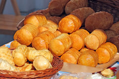 Food at the traditional street market. Traditional Polish smoked cheese known as oscypek at the market Stock Photography