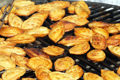 Food at the traditional street market. Traditional polish smoked cheese known as oscypek on barbecue Stock Photography