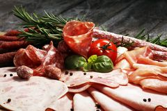 Food tray with delicious salami, pieces of sliced ham, sausage and salad. Meat platter selection. Food tray with delicious salami, pieces of sliced ham, sausage stock photos