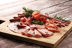 Food tray with delicious salami, pieces of sliced ham, sausage and salad. Meat platter selection. Food tray with delicious salami, pieces of sliced ham, sausage royalty free stock photos
