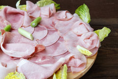 Food tray with delicious salami, pieces of sliced ham Stock Photo