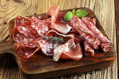 Food tray with delicious salami, raw ham and italian crudo or ja. Mon. Meat platter with selection Royalty Free Stock Photo