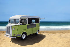 Food truck on the beach. Green retro fast food truck on the beach, horizontal template with copy space stock photography