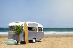 Food truck caravan on the beach. Surfing fast food truck, stream line caravan on the beach, template with copy space royalty free stock photo