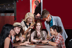 Food Truck Diners. Mixed group of hipsters with pizza at food truck royalty free stock images