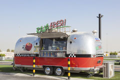 Food Truck in Dubai. DUBAI, UAE - NOV 27, 2016: Airstream caravan food truck at the Last Exit food trucks park on the E11 highway between Abu Dhabi and Dubai royalty free stock images