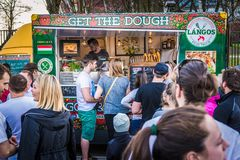 Food truck festival. Warsaw, Poland - April 1, 2017: People in front of food truck with Hungarian cuisine during food festival in Warsaw Stock Photography