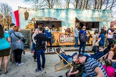 Food truck festival. Warsaw, Poland - April 1, 2017: People in front of food truck with Mexican cuisine during food festival in Warsaw Royalty Free Stock Photos
