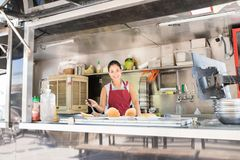 Food truck owner cooking some food Royalty Free Stock Images