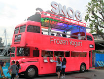 Food Truck. A shocking pink food truck, selling frozen yogurt, at the South Bank, London, UK stock image