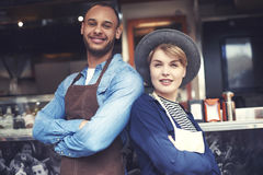Food truck workers. Portrait of couple selling food on the street Stock Photo