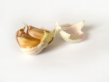 Food. Two cloves of garlic with peel on white background Royalty Free Stock Images