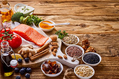 Food types for a healthy heart on rustic wood. Food types for a healthy heart and cardiovascular system on rustic wood with copy space with raw salmon, oats stock photography