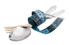 Food under control. Cutlery with a measuring tape, diet, moderate eating Royalty Free Stock Photos