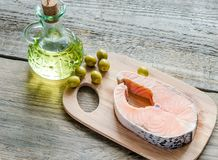 Food with unsaturated fats - salmon and olive oil Royalty Free Stock Photo