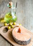 Food with unsaturated fats - salmon and olive oil Stock Images