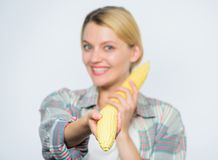 Food vegetarian and healthy natural organic products. Vegetarian menu. Healthy food concept. Food bring happiness. Woman. Hold yellow corn cob white background royalty free stock photo