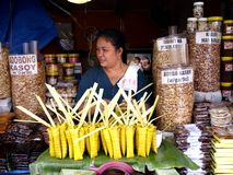 Food vendor in antipolo city philippines in asia. Sells suman or sweet sticky rice, cashew and peanuts royalty free stock photos