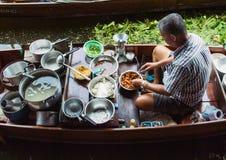 Food vendor at Damnoen Saduak Floating Market, Thailand. Royalty Free Stock Images
